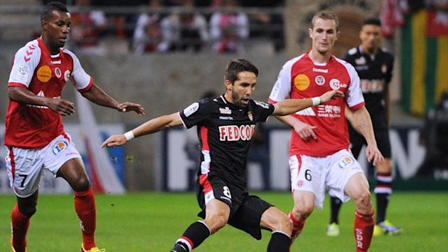 Monaco's Portuguese midfielder Joao Moutinho (C) swivels with the ball during their match with Reims (AFP)