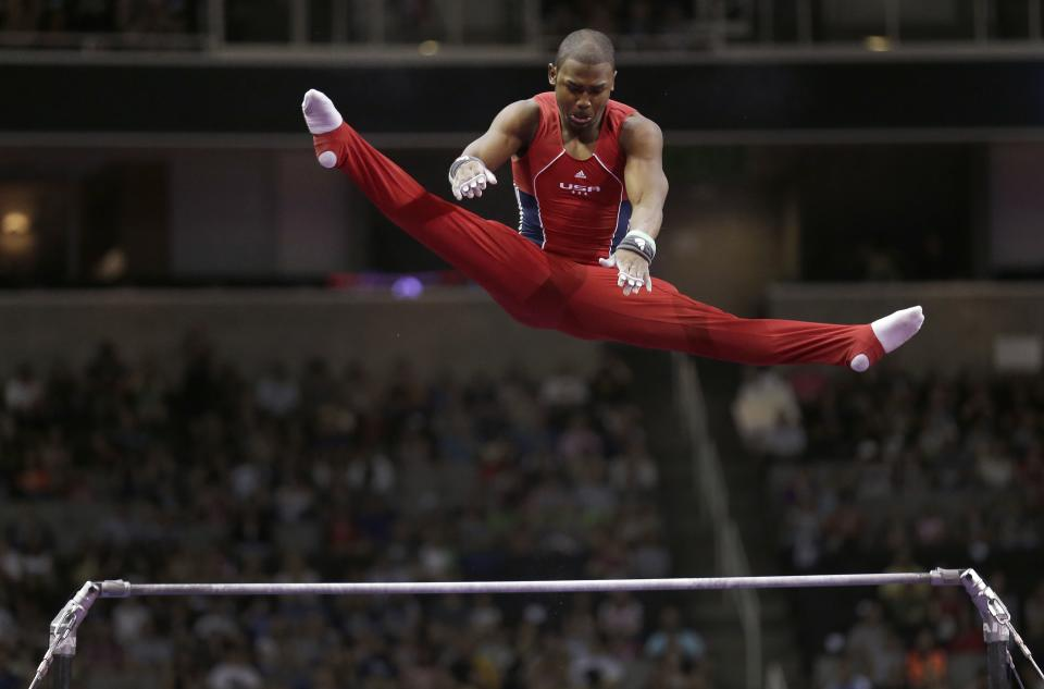 John Orozco soars above the horizontal bar during the final round of the men's Olympic gymnastics trials, Saturday, June 30, 2012, in San Jose, Calif. (AP Photo/Gregory Bull)