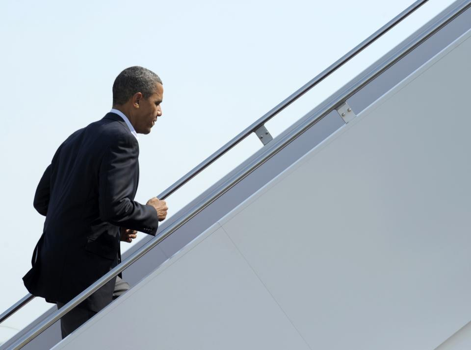 President Barack Obama walks up the steps of Air Force One at Andrews Air Force Base in Md., Thursday, July 5, 2012. Obama is heading to Ohio and Pennsylvania for a campaign bus trip. (AP Photo/Susan Walsh)