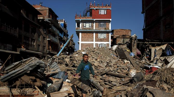 A local resident clears the rubble from his home which was destroyed after last week's earthquake in Bhaktapur