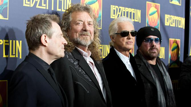"""FILE - This Oct. 9, 2012 file photo shows musicians, from left, John Paul Jones, Robert Plant, Jimmy Page and Jason Bonham at the""""'Led Zeppelin: Celebration Day"""" premiere in New York. CBS' """"60 Minutes"""" webcast reported Monday, May 6, 2013, that former President Clinton was enlisted to ask the British rock band to get back together last year for the Superstorm Sandy benefit concert in New York. He asked, they said no. David Saltzman of the Robin Hood Foundation says he and film executive Harvey Weinstein flew to Washington to ask Clinton to make the plea. Led Zeppelin's surviving members Robert Plant, John Paul Jones and Jimmy Page were in Washington just before the Sandy concert for the Kennedy Center Honors. Led Zeppelin last played publicly at a one-night reunion in London in 2007.  (Photo by Dario Cantatore/Invision/AP, file)"""