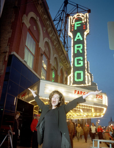 "In this photo taken March 21, 1996, ""Fargo"" Actress Kristin Rudrud poses at the movie screening, in front of the Fargo Theatre in Fargo, N.D. When the movie Fargo debuted in 1996, many residents in the North Dakota city were not fans of the film's dark humor, not to mention the heavy accents. But the fame and cash from the movie eventually brought many Fargo residents around. Now, 16 years later, Fargo awaits the debut of a new cable television show by the same name. And many residents are less apprehensive about how their hometown will be portrayed this time around. (AP Photo/The Forum, Nick Carlson)"