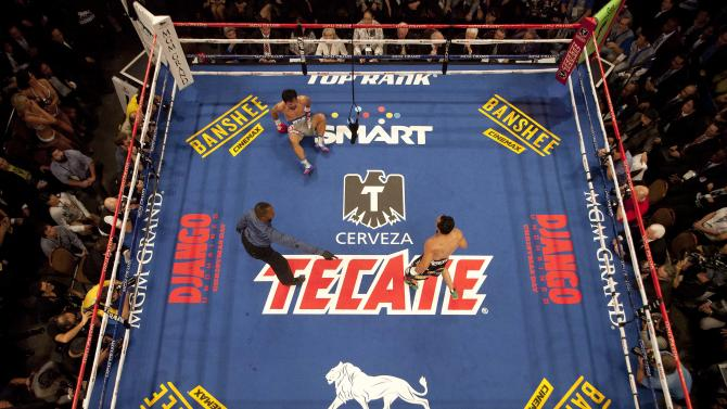 Referee Kenny Bayless, left, directs Juan Manuel Marquez, right, to a corner as Manny Pacquiao sits on the mat after being knocked down by Marquez in the third round during a welterweight fight, Saturday, Dec. 8, 2012, in Las Vegas. Marquez knocked out Pacquiao in the sixth round to win their fourth bout. (AP Photo/Julie Jacobson)