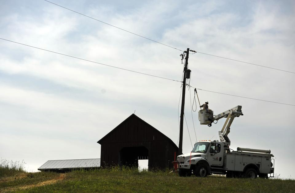 A Gulf Power lineman works to restore a power line in Middleburg, Va., Tuesday, July 3, 2012. Severe storms swept through the area leaving many homes and businesses without electricity. (AP Photo/Cliff Owen)