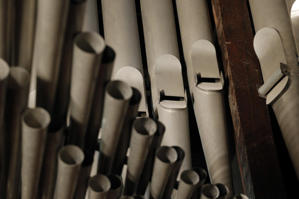This Thursday May 2, 2013 photo shows organ pipes at Notre Dame cathedral in Paris. The pipe organ was refurbished for the cathedral's 850th anniversary this year. (AP Photo/Christophe Ena)