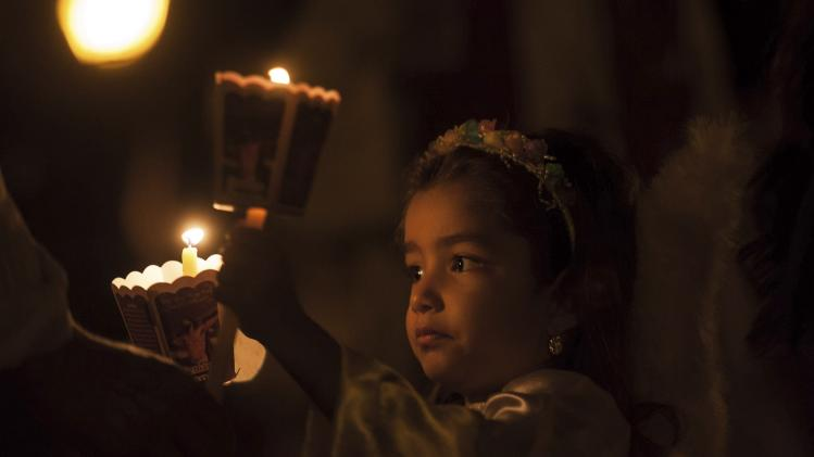 A Roman Catholic girl participates in a procession as part of Good Friday celebrations in Goias