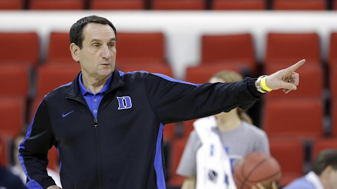 Duke head coach Mike Krzyzewski directs his team during practice at the NCAA college basketball tournament in Raleigh, N.C., Thursday, March 20, 2014. Duke plays Mercer in a second-round game on Friday