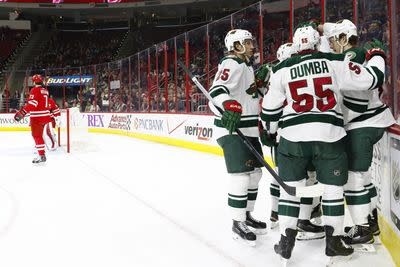 NHL Friday: Wild look to extend road streak in Carolina