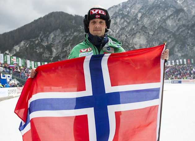 Alexander Stoeckl, head coach of Norwegian Skijumping Team waves with a Norwegian flag after final round of FIS Ski Flying World Cup 2011-2012 in Planica on March 18, 2012. AFP PHOTO / Jure Makovec (P