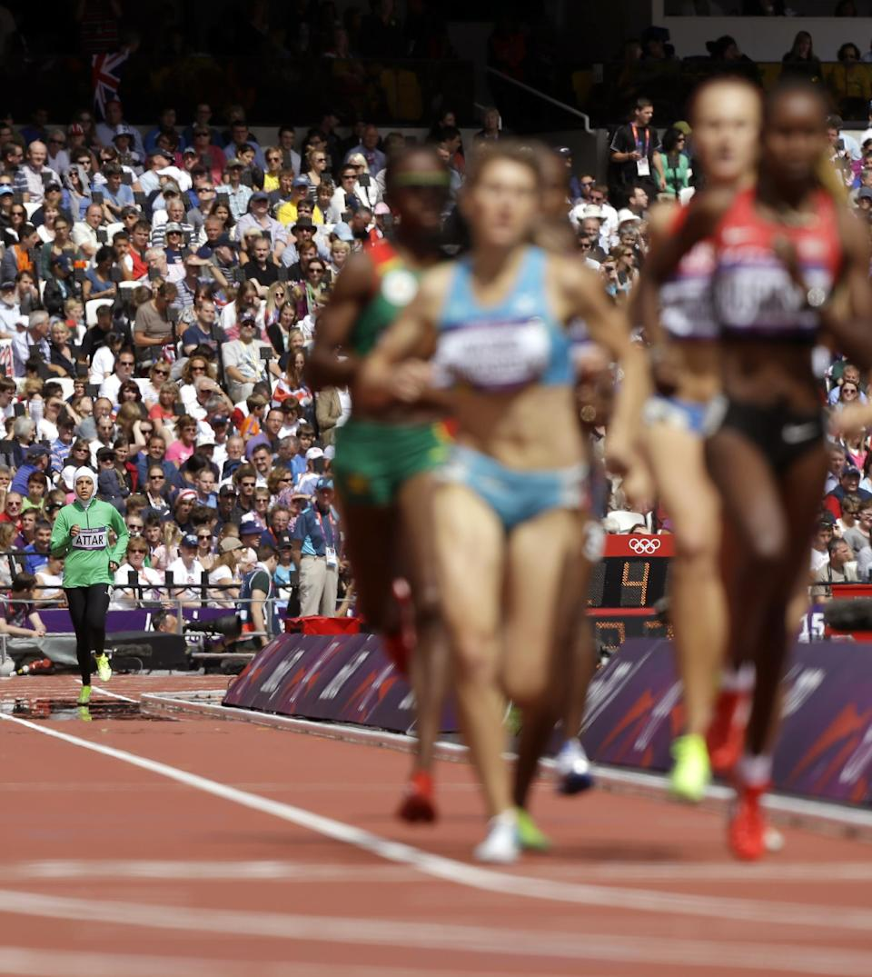 Saudi Arabia's Sarah Attar trails in a women's 800-meter heat during the athletics in the Olympic Stadium at the 2012 Summer Olympics, London, Wednesday, Aug. 8, 2012. Attar is the first Saudi woman to compete in athletics during the Olympics. (AP Photo/Anja Niedringhaus)