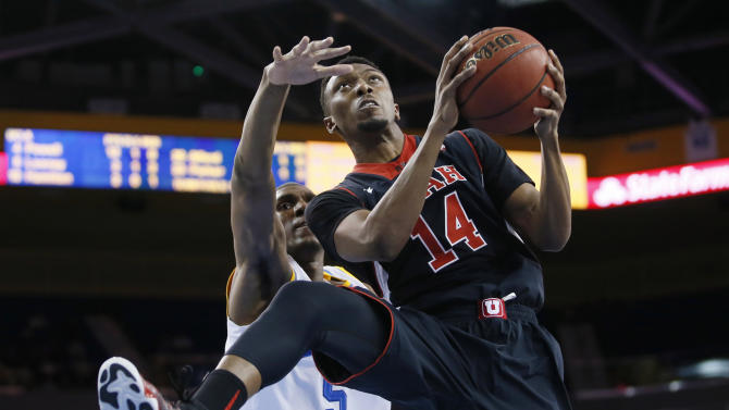 Utah's Dakarai Tucker, right, takes the ball to the basket in front of UCLA's Kevon Looney, left, during the first half of an NCAA college basketball game Thursday, Jan. 29, 2015, in Los Angeles. (AP Photo/Danny Moloshok)