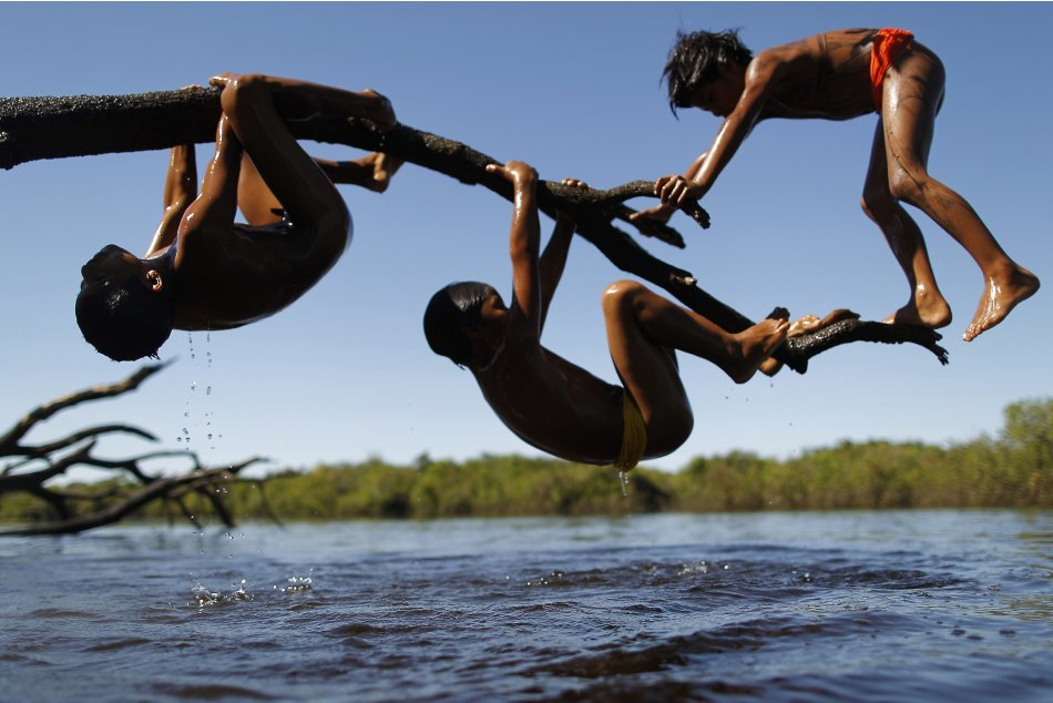 Yawalapiti children play over the Xingu River in the Xingu National Park