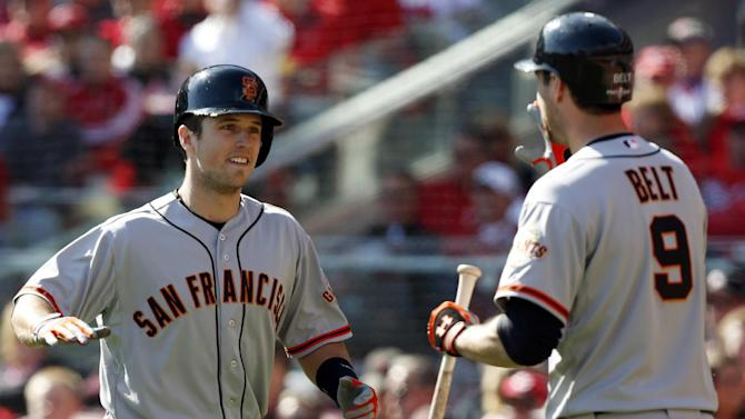 San Francisco Giants' Buster Posey is congratulated by Brandon Belt (9) after Posey hit a grand slam against the Cincinnati Reds in the fifth inning of Game 5 of the National League division baseball series, Thursday, Oct. 11, 2012, in Cincinnati. (AP Photo/David Kohl)
