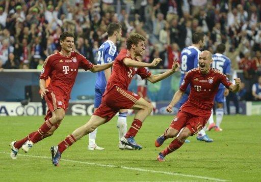Bayern Munich's forward Thomas Mueller (C) celebrates after scoring a goal