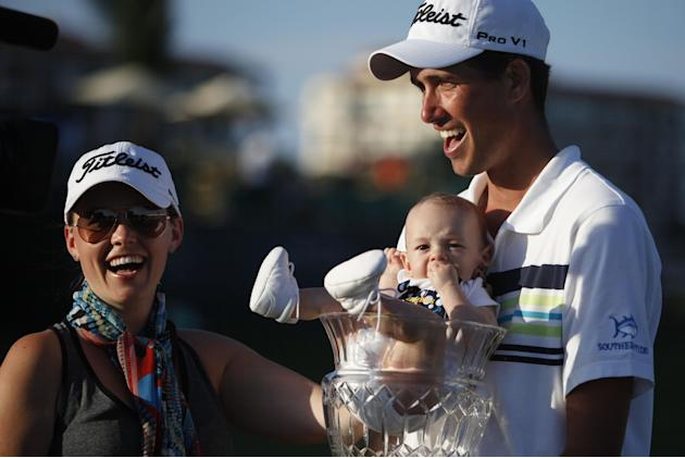 U.S.' Chesson Hadley celebrates with his wife Amanda and his newborn son Hughes, who sits inside his trophy, after winning the Puerto Rico Open PGA golf tournament in Rio Grande, Puerto Rico, Sund