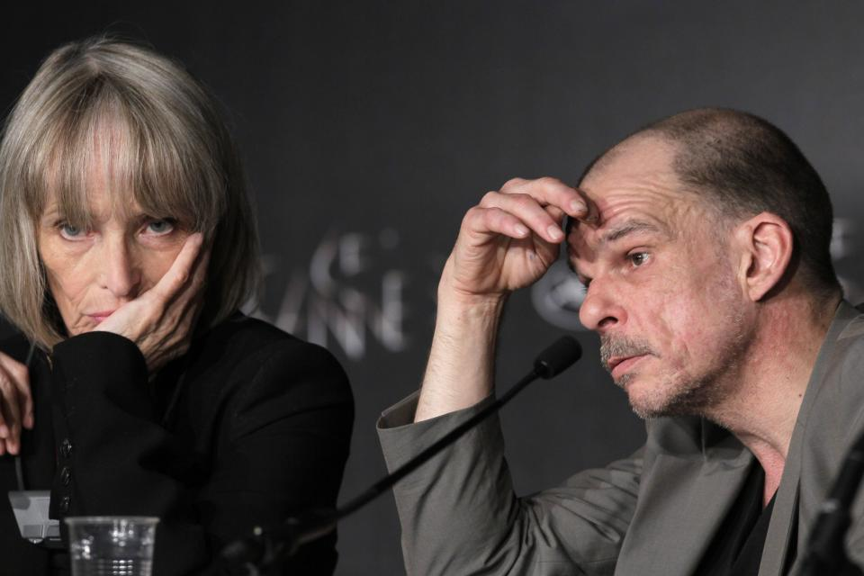 Actors Edith Scob, left and Denis Lavant listen during a press conference for Holy Motors at the 65th international film festival, in Cannes, southern France, Wednesday, May 23, 2012. (AP Photo/Francois Mori)
