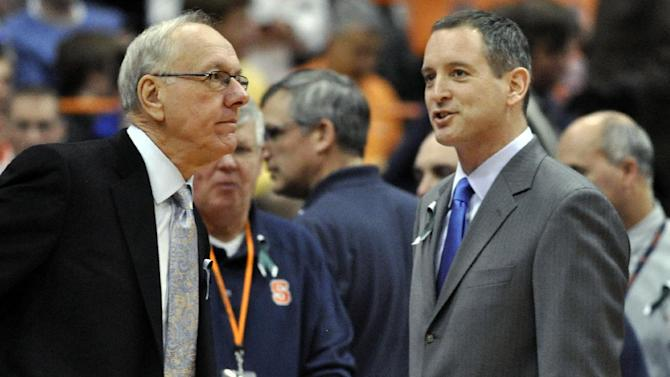 Syracuse head coach Jim Boeheim, left, and Rutgers head coach Mike Rice talk before an NCAA college basketball game in Syracuse, N.Y., Wednesday, Jan. 2, 2013. (AP Photo/Kevin Rivoli)