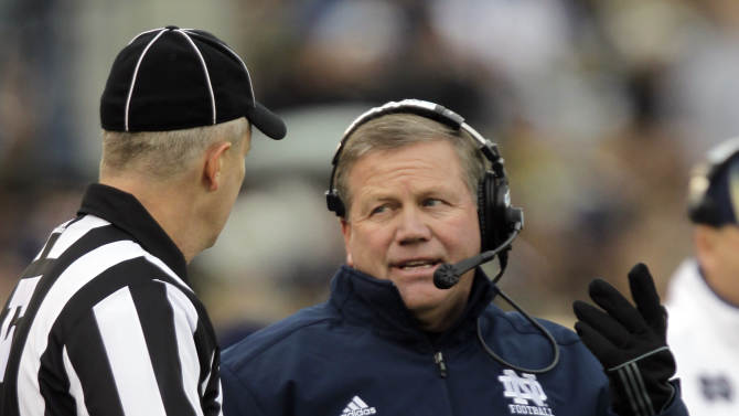 Notre Dame head coach Brian Kelly, right, questions field judge Ben Vasconcells as a play is reviewed during the first half of an NCAA college football game against the Pittsburgh in South Bend, Ind., Saturday, Nov. 3, 2012. (AP Photo/Michael Conroy)