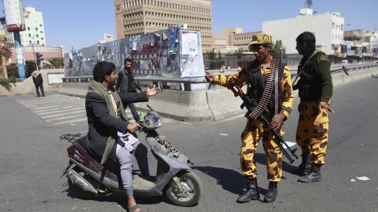 Police officers stop motorcyclist on road leading to Defence Ministry in Sanaa
