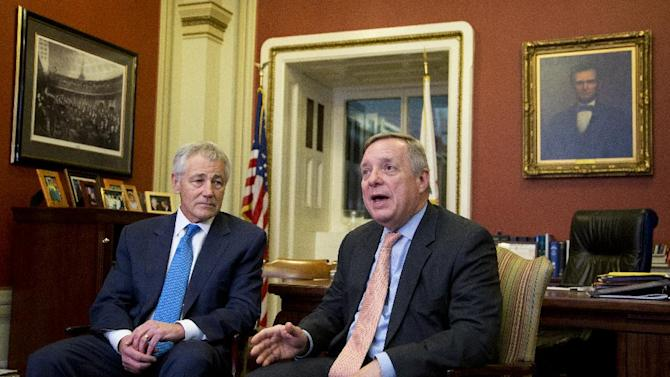 Sen. Dick Durbin, D-Ill., with Secretary of Defense-nominee and former Sen. Chuck Hagel, R-Neb., speaks to journalists following their meeting on Capitol Hill in Washington, Tuesday, Jan. 22, 2013.   (AP Photo/Manuel Balce Ceneta)