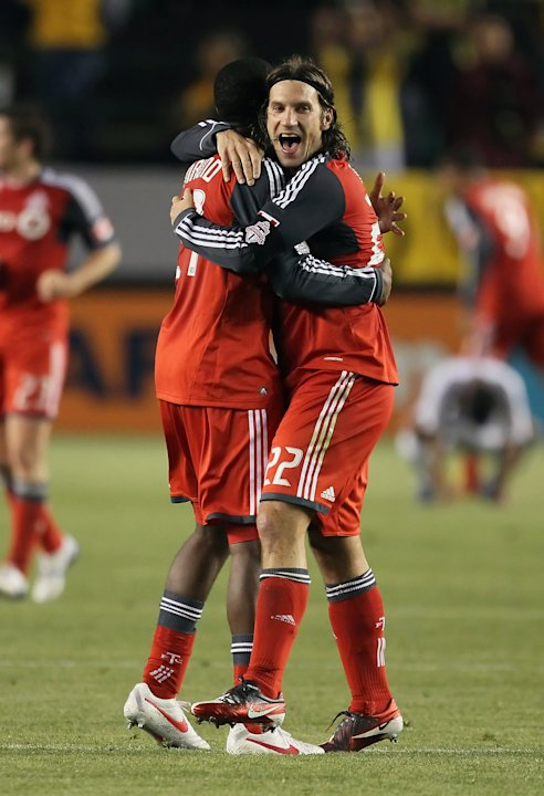 FILE - Aaron Maund (L) #21 and Torsten Frings #22 of Toronto FC celebrate their teams 2-1 victory over the Los Angeles Galaxy during a CONCACAF Champions League game at The Home Depot Center on March