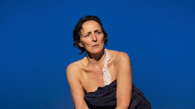 """This theater image released by Philip Rinaldi Publicity shows Fiona Shaw, perhaps best known for playing Harry Potter's aunt, portraying the mother of Christ in Irish writer Colm Toibin's world premiere stage adaptation of his novella """"The Testament of Mary,""""  at the Walter Kerr Theatre in New York. (AP Photo/Philip Rinaldi Publicity, Paul Kolnik)"""