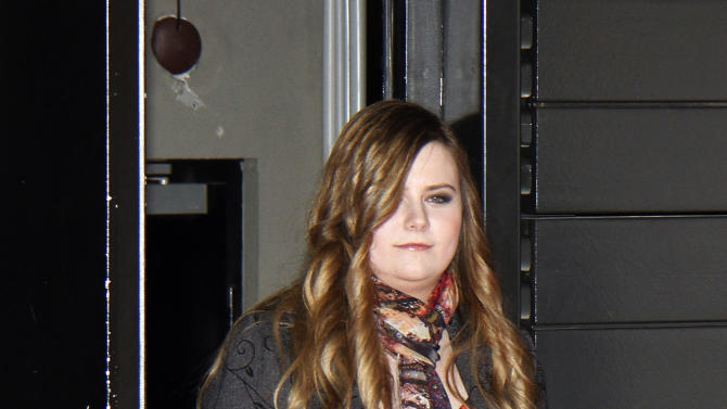 """Austrian Natascha Kampusch arrives for the premiere of the film """"3096 Days"""" in Vienna, Austria, Monday Feb. 25, 2013.  The film tells the story of Kampusch who was abducted as a schoolgirl and held prisoner in a cellar for almost nine years. (AP Photo/Ronald Zak)"""