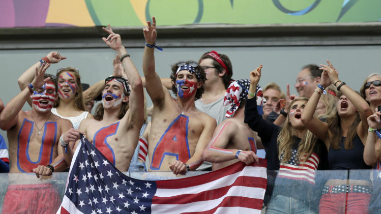 USA fans celebrate after team USA qualifying for the next World Cup round following their 1-0 loss to Germany during the group G World Cup soccer match between the USA and Germany at the Arena Pernambuco in Recife, Brazil, Thursday, June 26, 2014. (AP Photo/Julio Cortez)