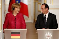 France's President Francois Hollande (R) and German Chancellor Angela Merkel attend a joint news conference at the Elysee Palace in Paris, May 30, 2013. REUTERS/Charles Platiau