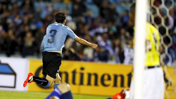 Uruguay's Godin celebrates after scoring against Colombia during their 2018 World Cup qualifying soccer match in Montevideo