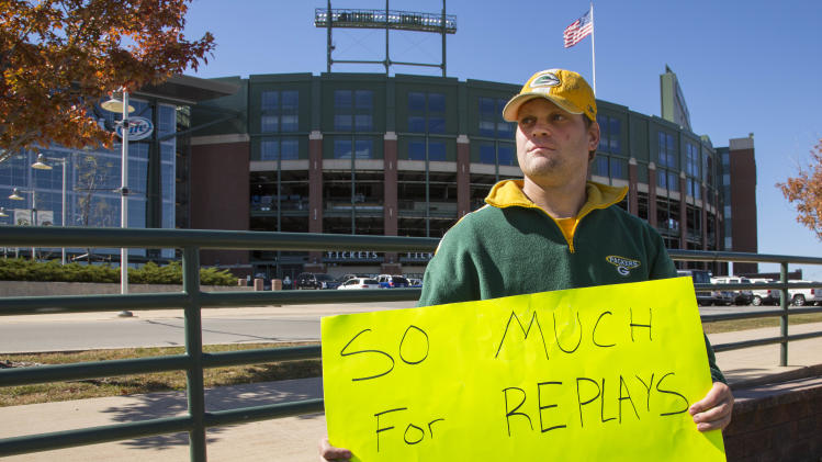 Green Bay Packers fan Mike LePak holds a sign in front of Lambeau Field on Lombardi Avenue, Tuesday, Sept. 25, 2012, in Green Bay, Wis., in protest of a controversial call in the Packers 14-12 loss to the Seattle Seahawks, Monday night in Seattle. Just when it seemed that NFL coaches, players and fans couldn't get any angrier, along came a fiasco that trumped any of the complaints from the weekend. (AP Photo/Mike Roemer)