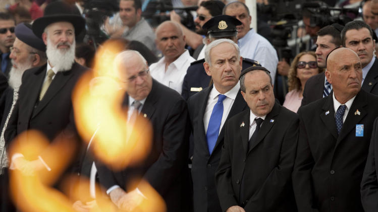 Israeli Prime Minister Benjamin Netanyahu, center, attends a state memorial ceremony on Remembrance Day for the fallen soldiers of Israel's wars, in Yad Lebanim soldiers Memorial in Jerusalem, Tuesday, April 24, 2012. (AP Photo/Abir Sultan, Pool)