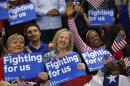 Supporters of Democratic presidential candidate Hillary Clinton cheer at her election night watch party after winning the South Carolina Democratic primary in Columbia, S.C., Saturday, Feb. 27, 2016. (AP Photo/Gerald Herbert)