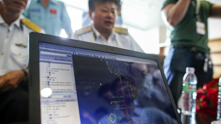 Map of flight plan is seen on computer screen during meeting before mission to find Malaysia Airlines flight MH370, at Phu Quoc Airport on Phu Quoc Island