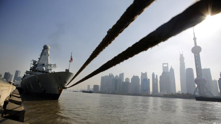 British Royal Navy destroyer HMS Daring is docked at the port area of Huangpu River after its arrival to Shanghai