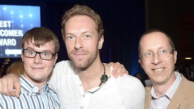 Chris Martin and Edward, recipient of the Nordoff Robbins Music Therapy and his dad at Nordoff Robbins O2 Silver Clef Awards 2013 at the London Hilton on Friday, June 28, 2013, in London. (Photo by Jon Furniss/Invision for O2/AP Images)