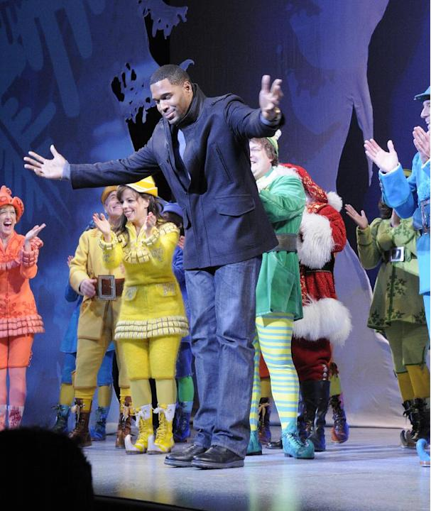 "This image released by ABC shows former NFL player Michael Strahan, center, bowing during a curtain call for the matinee show of the musical ""Elf,"" Wednesday, Dec. 5, 2012 in New York. Strahan, a co-h"