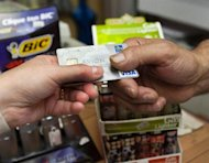 A consumer pays with a credit card at a store in Montreal. THE CANADIAN PRESS/Ryan Remiorz