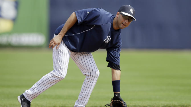 New York Yankees' Derek Jeter fields a grounder during a workout at baseball spring training, Wednesday, Feb. 20, 2013, in Tampa, Fla. (AP Photo/Matt Slocum)