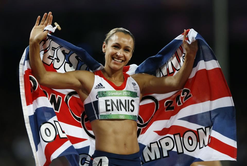 Britain's Jessica Ennis celebrates winning gold following the 800-meter heptathlon during the athletics in the Olympic Stadium at the 2012 Summer Olympics, London, Saturday, Aug. 4, 2012. (AP Photo/Daniel Ochoa De Olza)