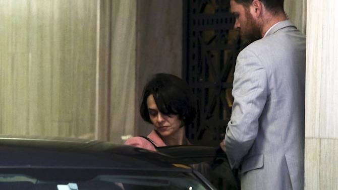 Delia Velculescu, the new IMF representative for Greece, gets into a car after a meeting at the Bank of Greece in Athens