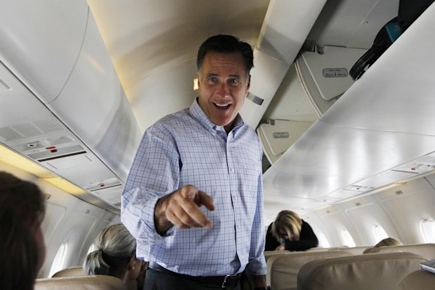 Republican presidential candidate, former Massachusetts Gov. Mitt Romney speaks to reporters as he boards his charter plane in Centennial, Colo., Thursday, Aug. 2, 2012, en route to Aspen, Colo. (AP Photo/Charles Dharapak)