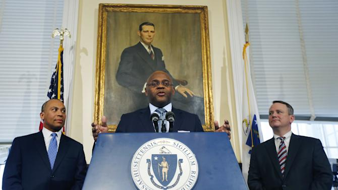 "William ""Mo"" Cowan, center, flanked by Massachusetts Gov. Deval Patrick, left, and Massachusetts Lt. Gov. Tim Murray, right, gestures as he speaks during a news conference at the Statehouse in Boston, Wednesday, Jan. 30, 2013, where he was named interim U.S. Senator for the seat vacated with the resignation of Sen. John Kerry, D-Mass. who will become secretary of state.  (AP Photo/Charles Krupa)"