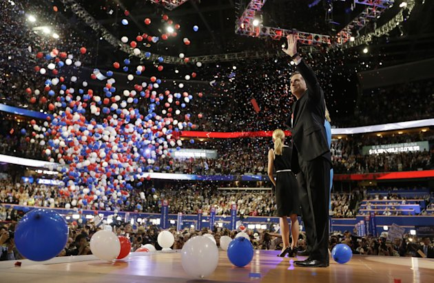 Republican presidential nominee Mitt Romney waves to delegates after his speech at the Republican National Convention in Tampa, Fla., on Thursday, Aug. 30, 2012, as the balloons fall.  (AP Photo/David