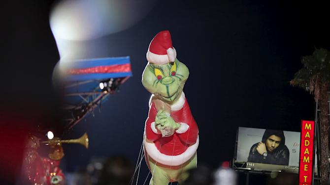 A Dr. Seuss The Grinch balloon appears in the 84th Annual Hollywood Christmas Parade in the Hollywood section of Los Angeles