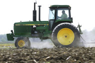 <p> FILE - In this April 2, 2012 file photo, Derek Long uses a John Deere tractor to disk and cultivate a field in preparation for planting corn in Loami, Ill. John Deere & Co. reports quarterly earnings on Wednesday, Aug. 14, 2013. . (AP Photo/Seth Perlman, File)