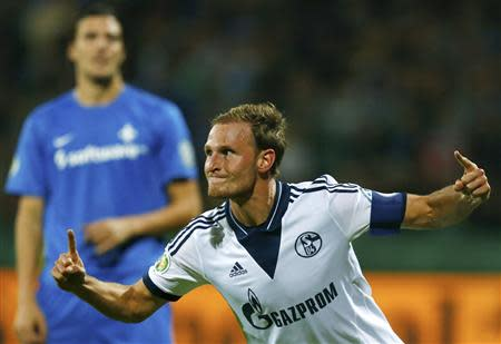 Schalke 04's Hoewedes celebrates his goal against Darmstadt 98 during their German soccer cup second round match in Darmstadt