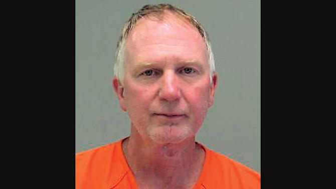 This undated booking photo released by the Lenawee County sheriff's department in Adrian, Mich., shows farmer Edwin Schmieding, 61, who was arrested on a marijuana growing charge after authorities found 8,000 plants at his farm in 2011. On Tuesday, June 25, 2013, U.S. District Judge Bernard Friedman in Detroit decided not to order Schmieding to prison and instead placed him on probation. The judge said the decision was based partly to many handwritten letters from supporters who described him as a modest, selfless man who helps others at every turn. (AP Photo/Lenawee County Sheriff's Department)