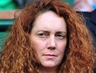 News International chief Rebekah Brooks, seen here on July 1, has resigned amid the phone-hacking scandal engulfing the British newspaper group, a News Corp. spokeswoman said