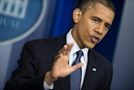 US President Barack Obama pauses while answering questions after a press briefing in the White House on June 8. Obama urged European leaders to stabilize banks and to ease up on extreme austerity prgrammes